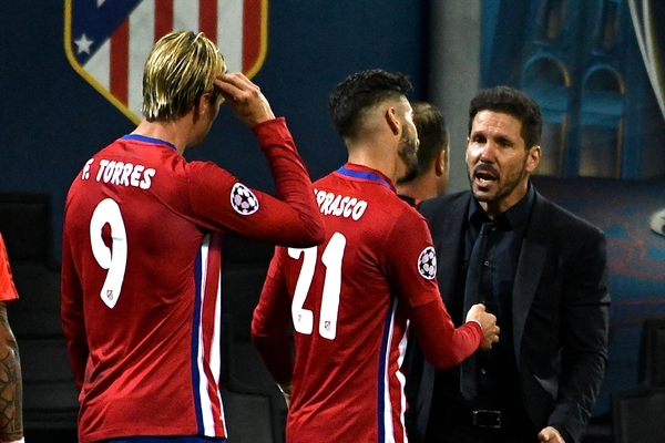 Atletico Madrid manager Diego Simeone (right) congratulates Yannick Ferreira Carrasco (centre) after he scores their first goal to make it Real Madrid 1 Atletico Madrid 1 during the UEFA Champions League Final at San Siro, Milan, Italy. Picture by Kristian Kane/Focus Images Ltd 07814482222 28/05/2016