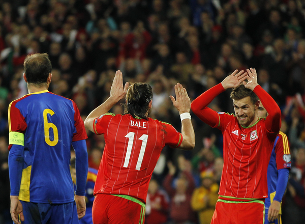 Gareth Bale celebrates the second goal for Wales with team mate Aaron Ramsey against Andorra during the UEFA Euro 2016 Qualifying match at the Cardiff City Stadium, Cardiff Picture by Mike Griffiths/Focus Images Ltd +44 7766 223933 13/10/2015