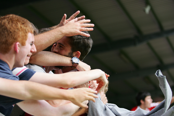 Picture by Rob Fisher/Focus Images Ltd +44 7450 945824 10/08/2013 Will Grigg of Brentford is mobbed by fans celebrating after scoring their third goal against Sheffield Utd during the Sky Bet League 1 match at Griffin Park, London.