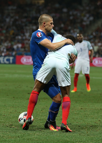 Raheem Sterling of England does battle with Johann Gudmundsson of Iceland during the UEFA Euro 2016 match at Stade de Nice, Nice Picture by Paul Chesterton/Focus Images Ltd +44 7904 640267 27/06/2016