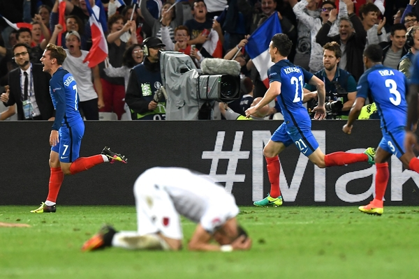 Antoine Griezmann of France (left) celebrates scoring their first goal to make it France 1 Albania 0 during the UEFA Euro 2016 match at Stade Velodrome, Marseille Picture by Kristian Kane/Focus Images Ltd 07814482222 15/06/2016