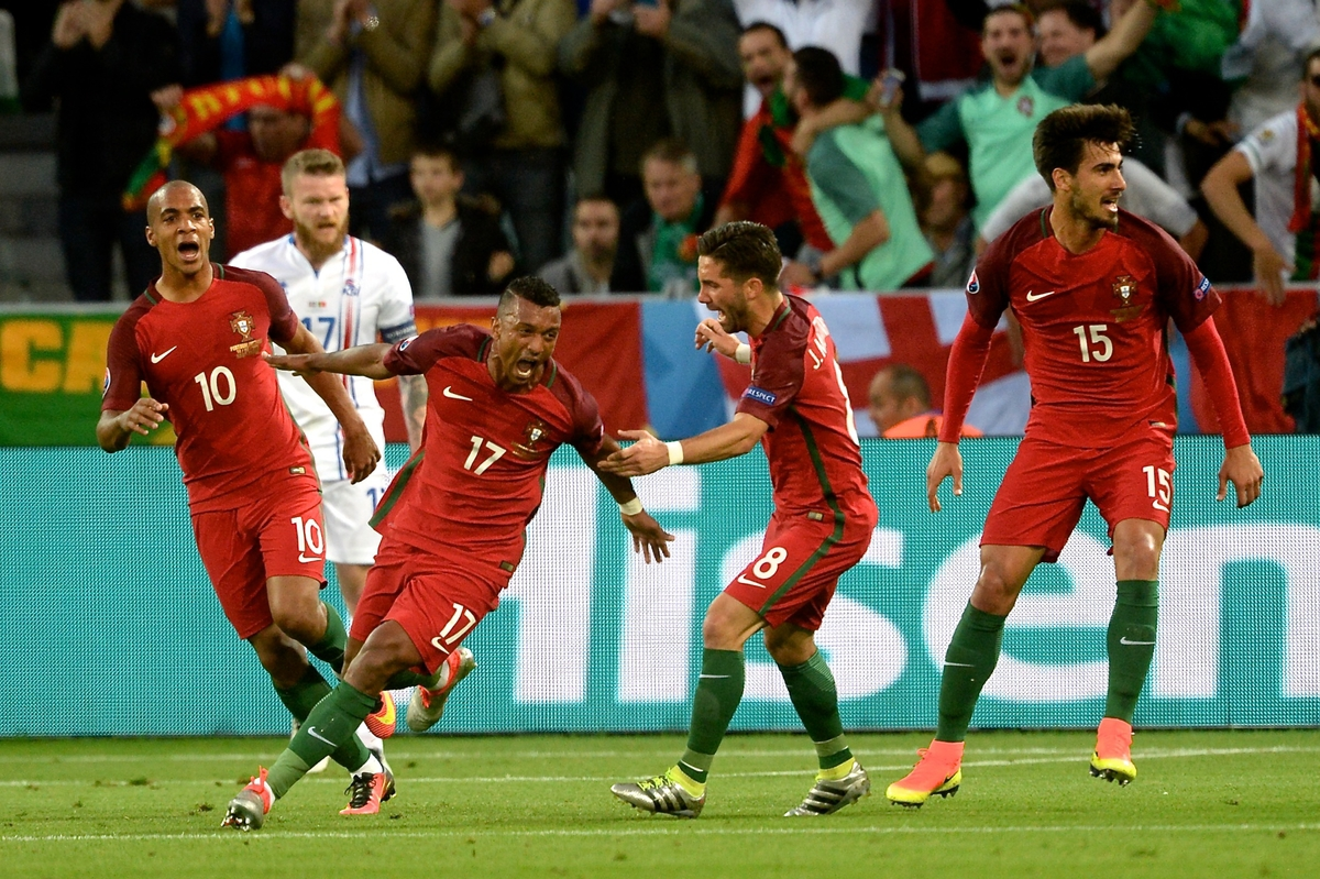 Nani of Portugal (2nd left) celebrates scoring their first goal to make it Portugal 1 Iceland 0 during the UEFA Euro 2016 match at Stade Geoffroy-Guichard, Saint-Étienne, France Picture by Kristian Kane/Focus Images Ltd 07814482222 14/06/2016