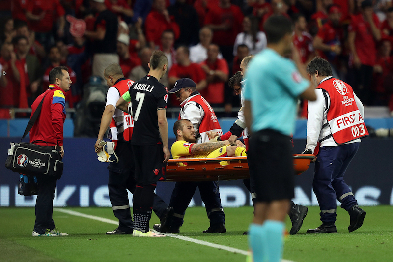Denis Alibec of Romania is injured and has to leave the match on a stretcher during the UEFA Euro 2016 match at Stade de Lyons, Lyons Picture by Paul Chesterton/Focus Images Ltd +44 7904 640267 19/06/2016