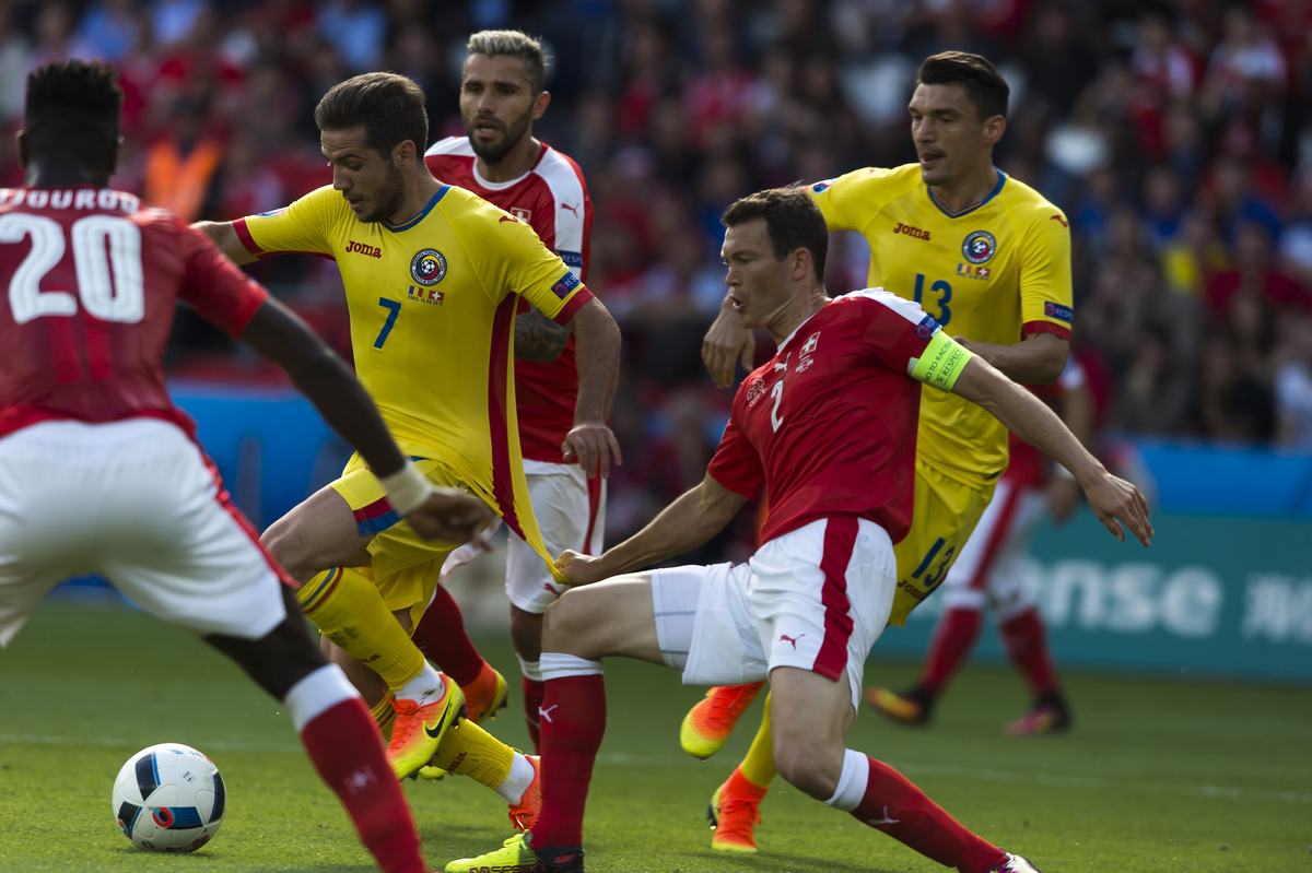 Alexandra Chipciu of Romania is pulled down by StephanLichtsteiner of Switzerland during the UEFA Euro 2016 match at Stade de France, Paris Picture by Anthony Stanley/Focus Images Ltd 07833 396363 15/06/2016