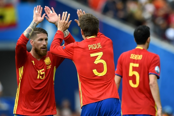 Gerard Piqué of Spain (2nd left) celebrates with Sergio Ramos after scoring their first goal to make it Spain 1 Czech Republic 0 during the UEFA Euro 2016 match at Stadium de Toulouse, Toulouse Picture by Kristian Kane/Focus Images Ltd 07814482222 13/06/2016