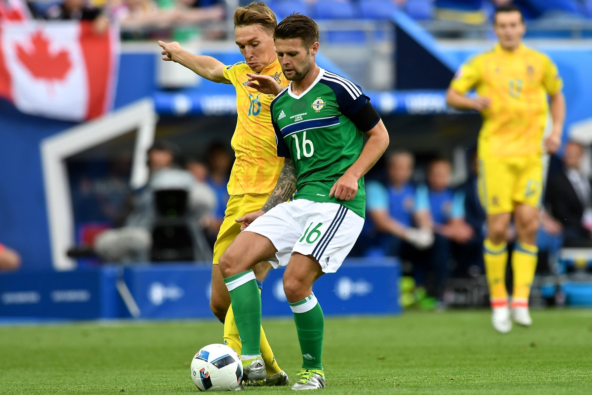 Oliver Norwood of Northern Ireland holds off Serhiy Sydorchuk of Ukraine during the UEFA Euro 2016 match at Stade de Lyon, Lyon Picture by Kristian Kane/Focus Images Ltd 07814482222 16/06/2016