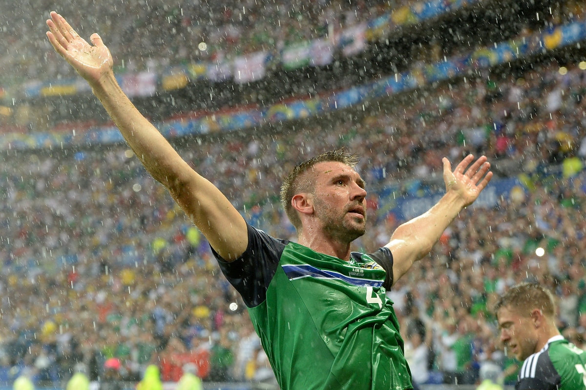 Gareth McAuley of Northern Ireland celebrates scoring their first goal to make it Northern Ireland 1u 0 during the UEFA Euro 2016 match at Stade de Lyon, Lyon Picture by Kristian Kane/Focus Images Ltd 07814482222 16/06/2016