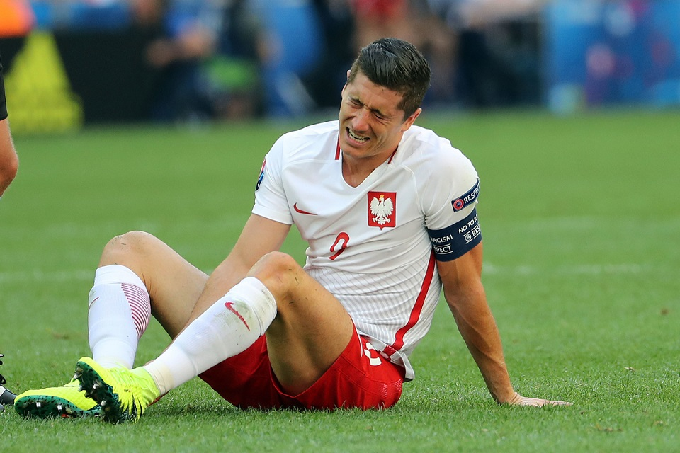 Robert Lewandowski of Poland takes a knock during the UEFA Euro 2016 match at Stade Velodrome, Marseille Picture by Paul Chesterton/Focus Images Ltd +44 7904 640267 21/06/2016