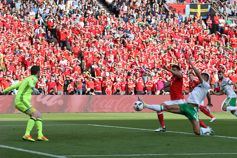 Gareth McAuley of Northern Ireland puts the ball into his own net from a cross by Gareth Bale of Wales to make the score one nil to Wales during the UEFA Euro 2016 match at Parc des Princes, Paris Picture by Paul Chesterton/Focus Images Ltd +44 7904 640267 25/06/2016