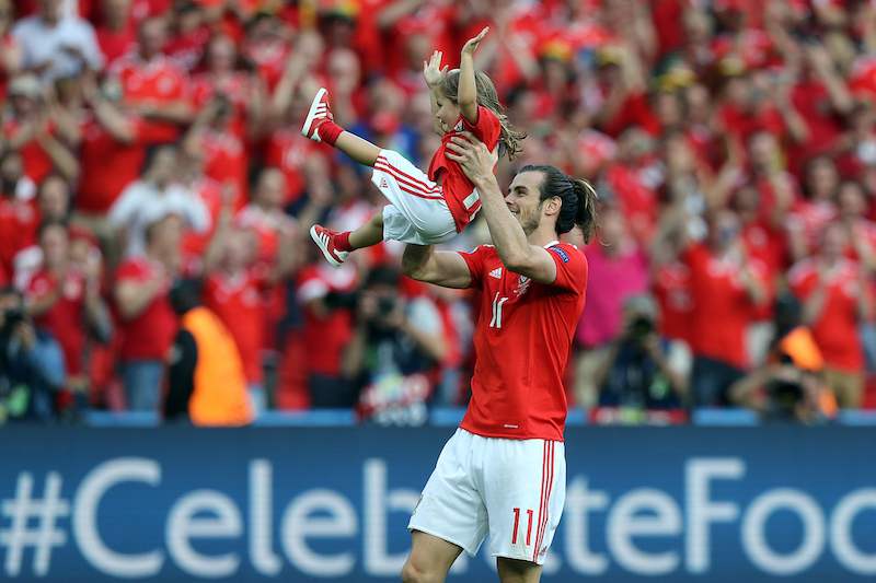 Gareth Bale of Wales chases his daughter Alba Violet then hold her aloft at the end of the UEFA Euro 2016 match at Parc des Princes, Paris Picture by Paul Chesterton/Focus Images Ltd +44 7904 640267 25/06/2016