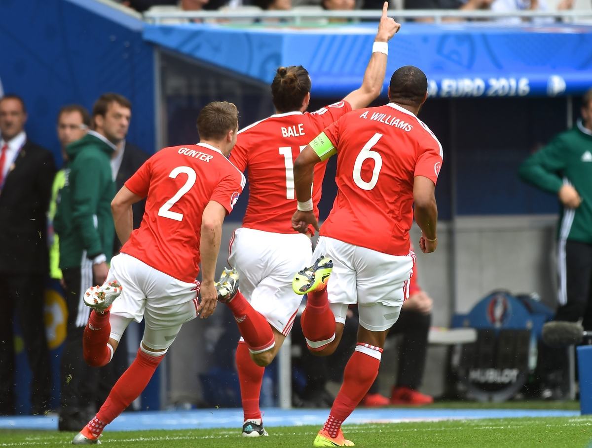 Gareth Bale of Wales (centre) celebrates scoring their first goal to make it Wales 1 Slovakia 0 the UEFA Euro 2016 match at Stade de Bordeaux, Bordeaux Picture by Kristian Kane/Focus Images Ltd 07814482222 11/06/2016