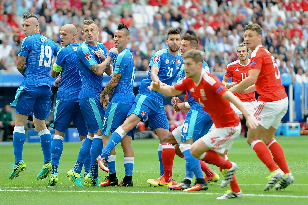 Slovakia defenders watch as the free kick from Gareth Bale of Wales (2nd right) goes in to make it Wales 1 Slovakia 0 the UEFA Euro 2016 match at Stade de Bordeaux, Bordeaux Picture by Kristian Kane/Focus Images Ltd 07814482222 11/06/2016