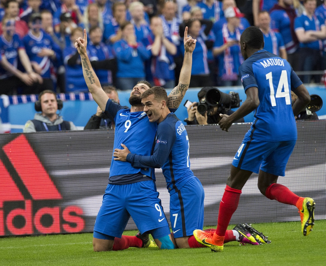 Olivier Giroud of France celebrates with Antoine Griezmann and Blaise Matuidi after scoring France's first goal against Iceland during the UEFA Euro 2016 quarter final match at Stade de France, Paris Picture by Anthony Stanley/Focus Images Ltd 07833 396363 03/07/2016