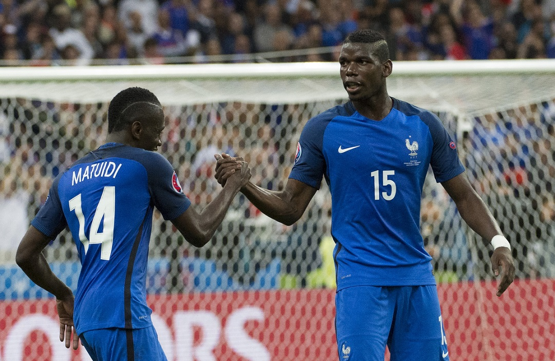 Blaise Matuidi and Paul Pogba of France celebrate Dimitri Payets goal during the UEFA Euro 2016 quarter final match at Stade de France, Paris Picture by Anthony Stanley/Focus Images Ltd 07833 396363 03/07/2016