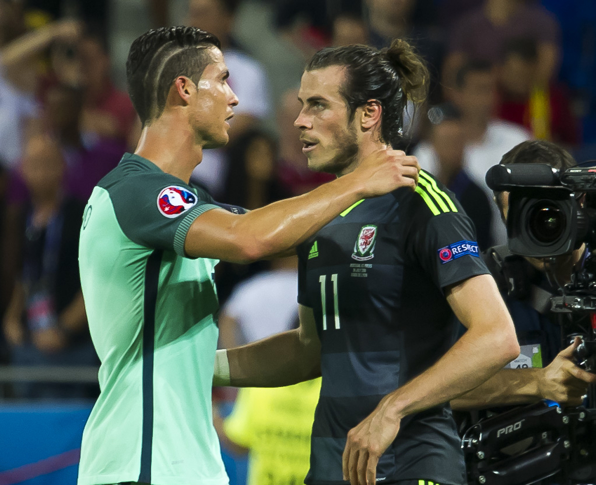 Cristiano Ronaldo of Portugal pictured commiserating with Gareth Bale of Wales after the UEFA Euro 2016 match at Stade de Lyons, Lyons Picture by Anthony Stanley/Focus Images Ltd 07833 396363 06/07/2016