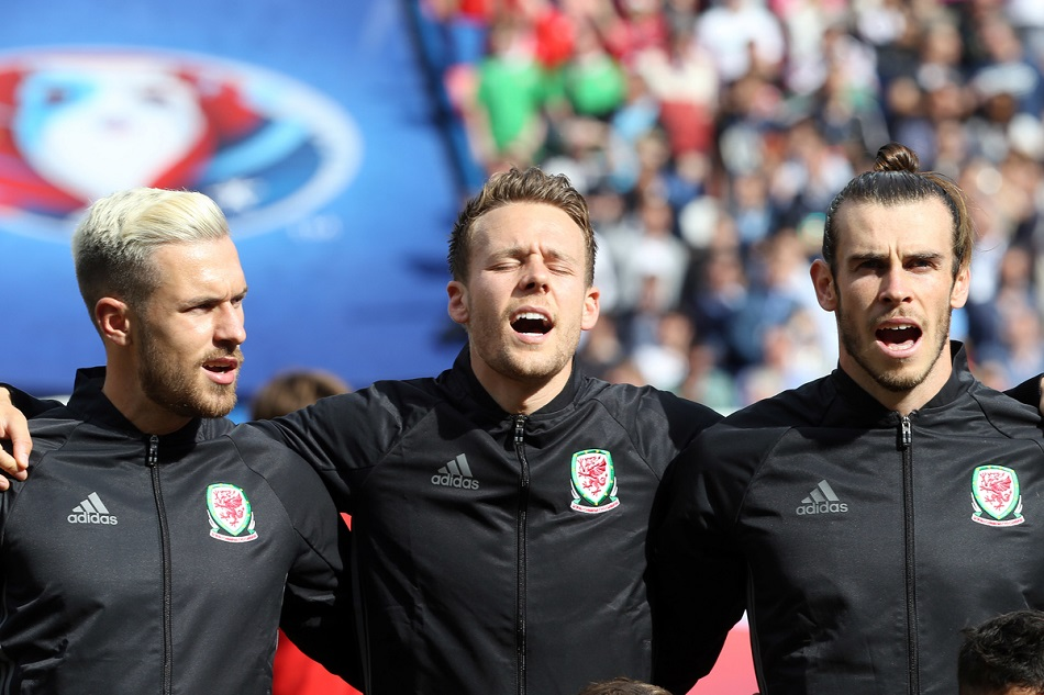 Aaron Ramsey of Wales, Wayne Hennessey of Wales and Gareth Bale of Wales sing the National Anthem before the UEFA Euro 2016 match at Parc des Princes, Paris Picture by Paul Chesterton/Focus Images Ltd +44 7904 640267 25/06/2016