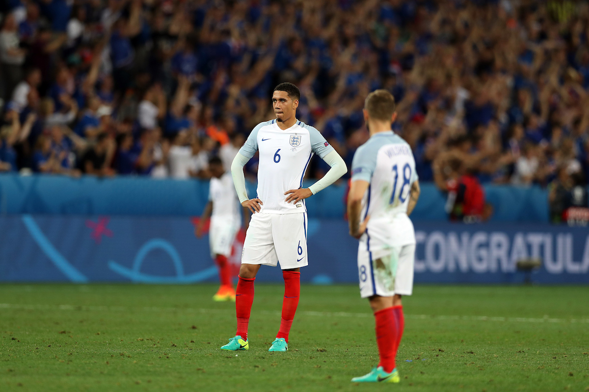 Chris Smalling of England and Jack Wilshere of England look dejected at the end of the UEFA Euro 2016 match at Stade de Nice, Nice Picture by Paul Chesterton/Focus Images Ltd +44 7904 640267 27/06/2016