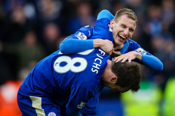 Marc Albrighton of Leicester City (right) celebrates scoring their fourth goal with Christian Fuchs of Leicester City (left) during the Barclays Premier League match at the King Power Stadium, Leicester Picture by Andy Kearns/Focus Images Ltd 0781 864 4264 24/04/2016