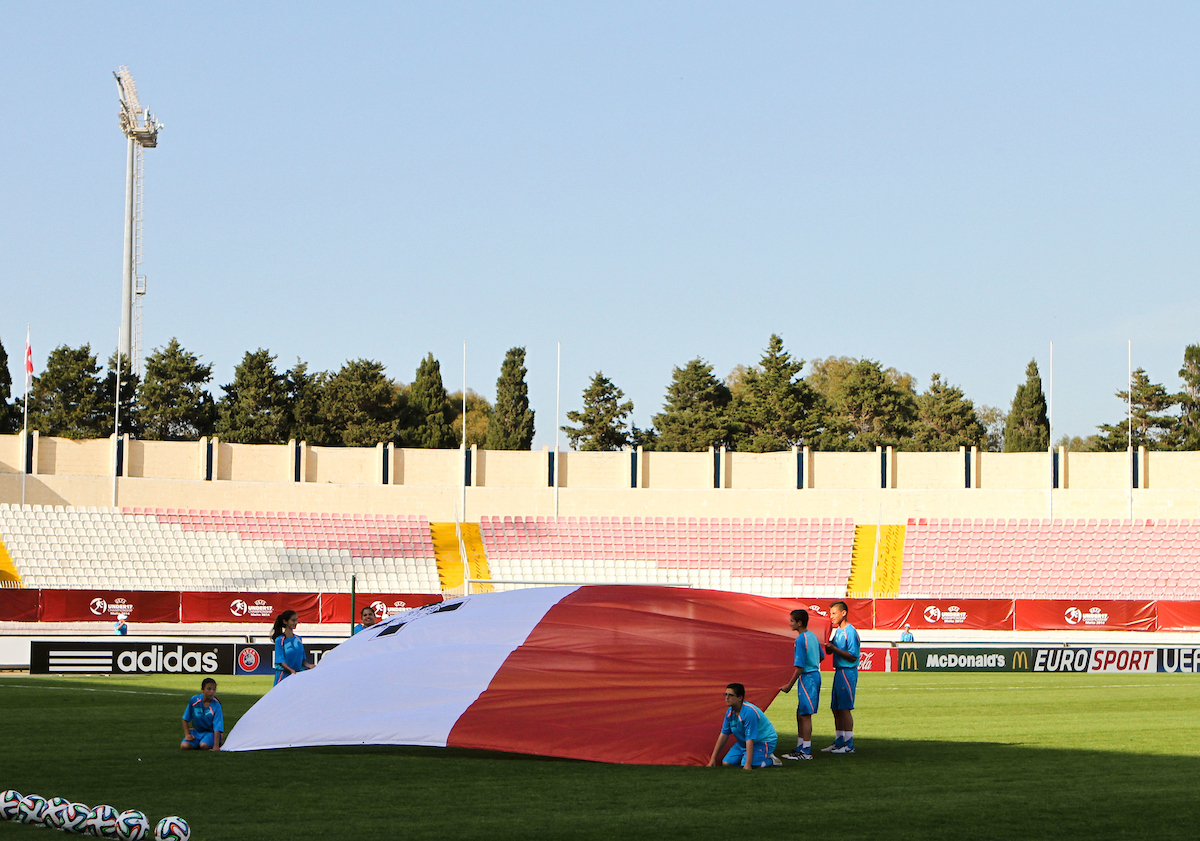 The flag of Malta is held by tournament mascots on the pitch before the 2014 UEFA European Under-17 match at Ta' Qali National Stadium, Attard Picture by Tom Smith/Focus Images Ltd 07545141164 09/05/2014