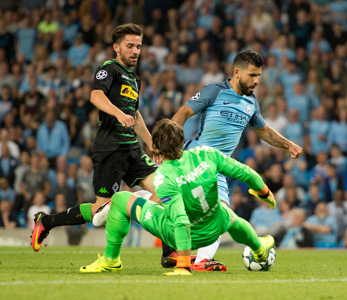 Sergio Aguero of Manchester City (right) goes round Borussia Monchengladbach goalkeeper Yann Sommer before scoring to make it 3-0 during the UEFA Champions League match at the Etihad Stadium, Manchester Picture by Russell Hart/Focus Images Ltd 07791 688 420 14/09/2016
