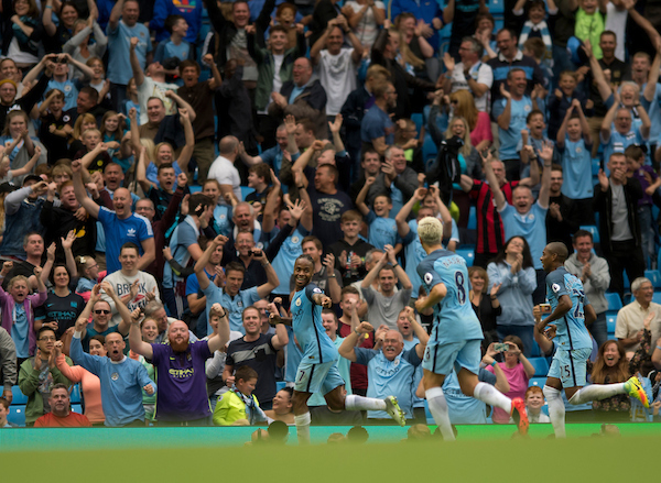 Raheem Sterling of Manchester City (left) celebrates after scoring his team's 3rd goal to make it 3-1 during the Premier League match at the Etihad Stadium, Manchester Picture by Russell Hart/Focus Images Ltd 07791 688 420 28/08/2016