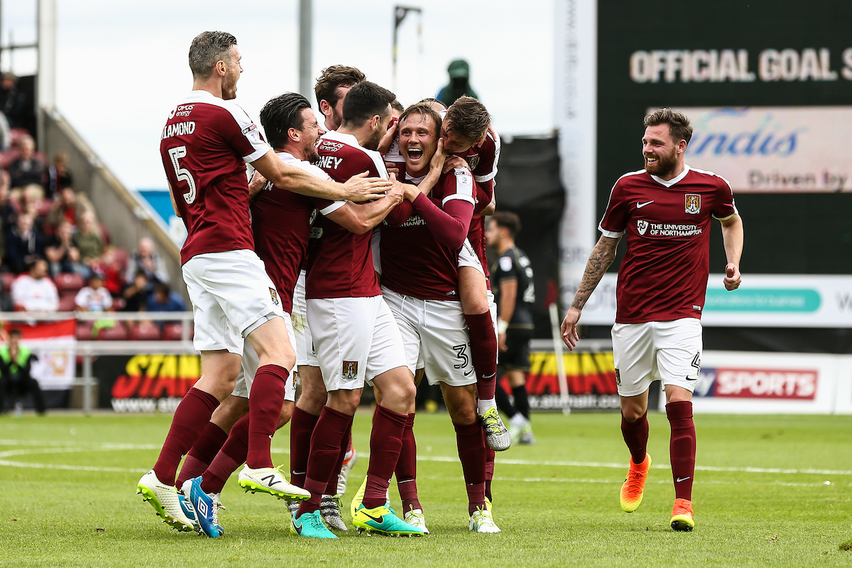 Northampton players celebrate their third goal by Matt Taylor of Northampton Town (centre) during the Sky Bet League 1 match at Sixfields Stadium, Northampton Picture by Andy Kearns/Focus Images Ltd 0781 864 4264 03/09/2016