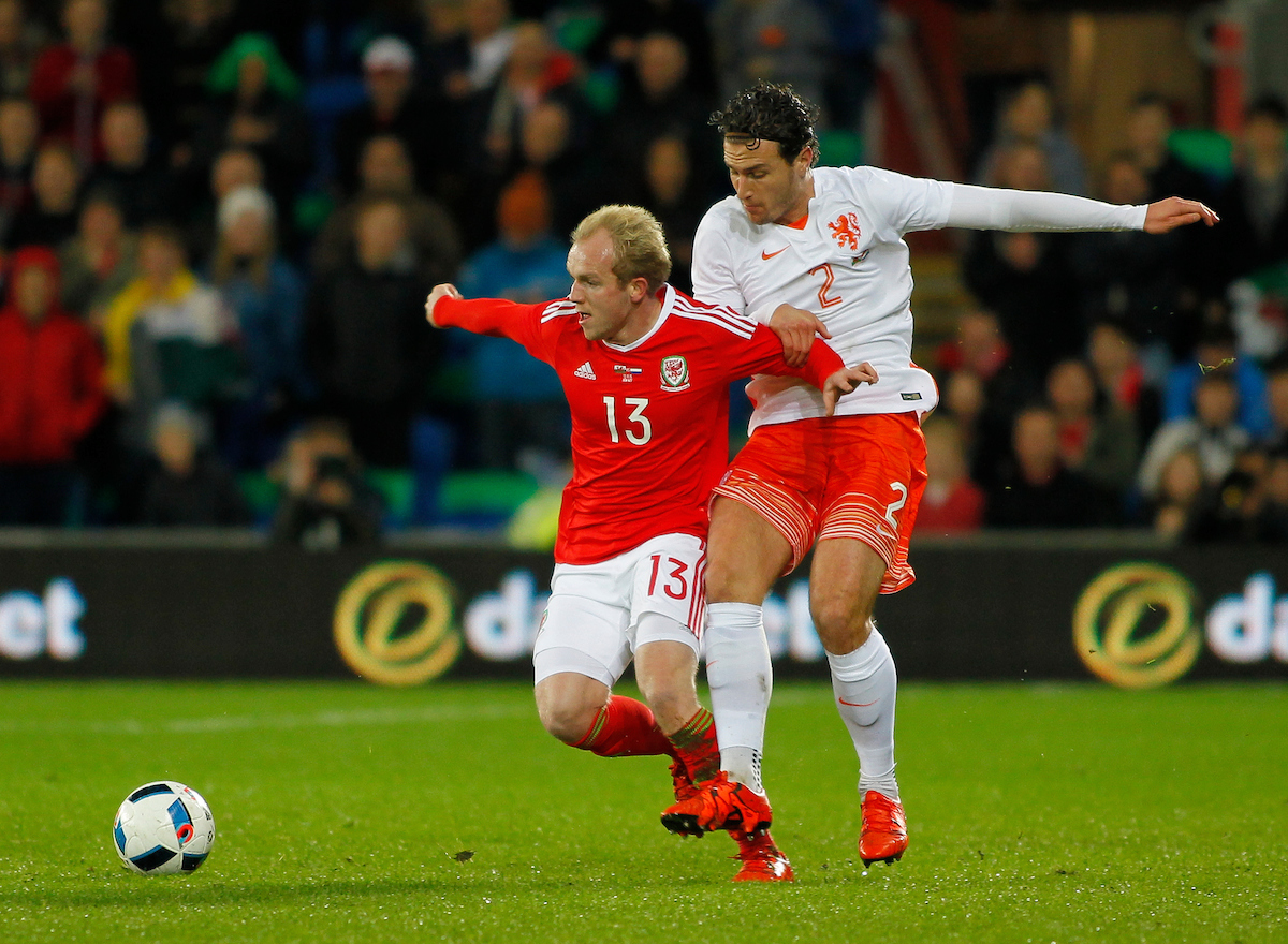 Jonathan Williams of Wales and Daryl Janmaat of Netherlands during the International Friendly match at the Cardiff City Stadium, Cardiff Picture by Mike Griffiths/Focus Images Ltd +44 7766 223933 13/11/2015