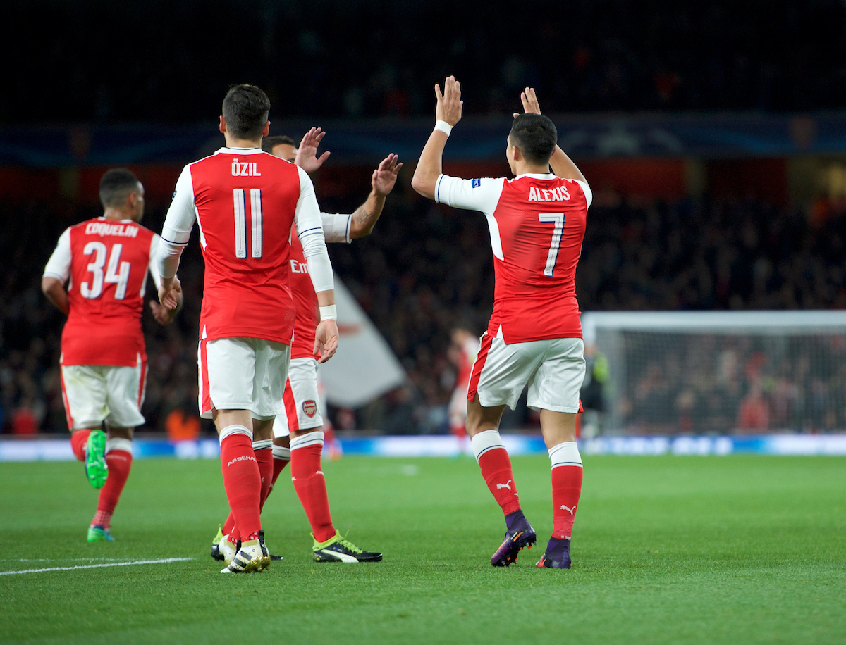 Alexis Sanchez of Arsenal celebrates with his team mates after scoring the opening goal during the UEFA Champions League match at the Emirates Stadium, London Picture by Alan Stanford/Focus Images Ltd +44 7915 056117 19/10/2016