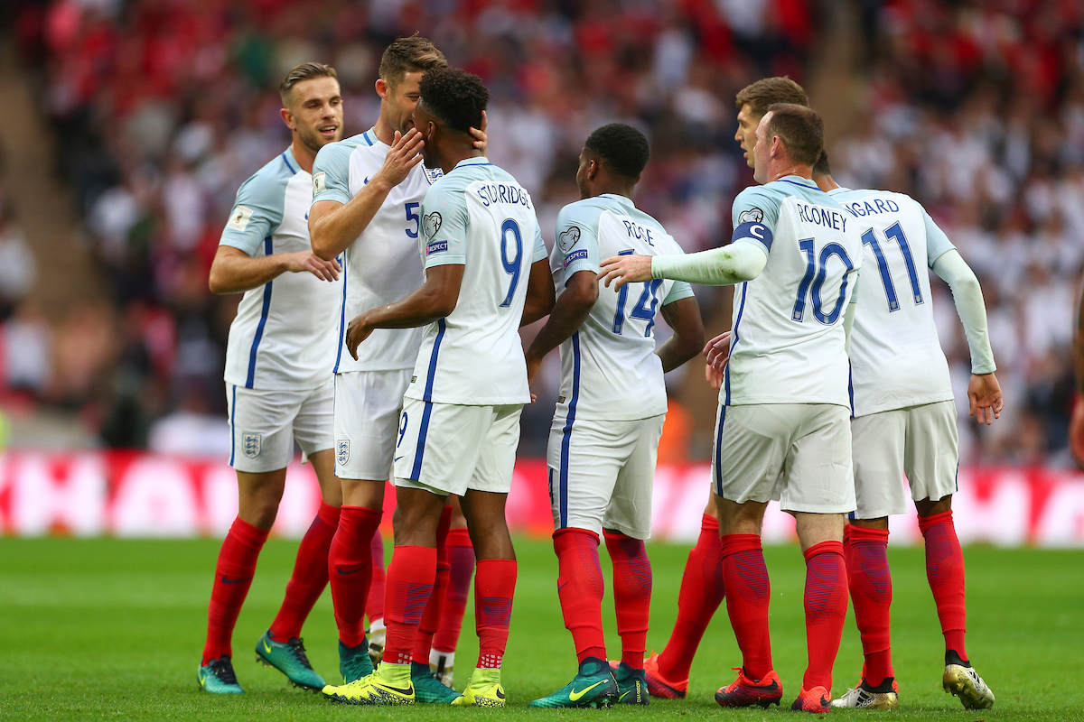 The England players surround and congratulate Daniel Sturridge after he scores to make it 1-0 during the 2018 FIFA World Cup Qualifying match at Wembley Stadium, London Picture by Ryan Dinham/Focus Images Ltd +44 7900 436859 08/10/2016