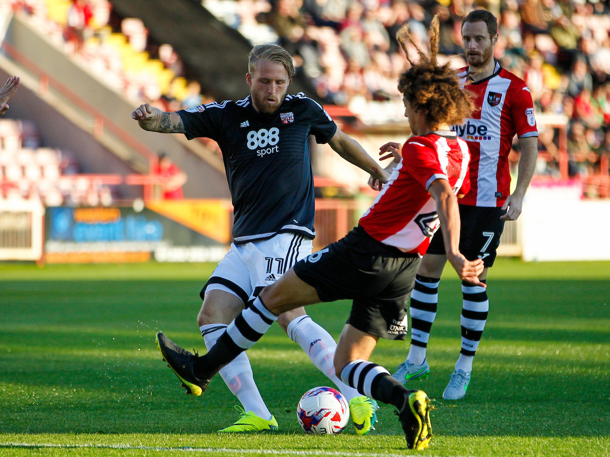 Philipp Hofmann of Brentford and Ethan Ampadu of Exeter City during the EFL Cup match between Exeter City and Brentford at St James' Park, Exeter Picture by Mark D Fuller/Focus Images Ltd +44 7774 216216 09/08/2016