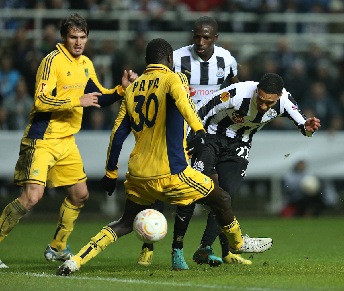 Picture by Paul Gaythorpe/Focus Images Ltd +447771 871632.14/02/2013.Sylvain Marveaux of Newcastle United get in a shot through the legs of Papa Gueye of Metalist Kharkiv during the UEFA Europa League match at St. James's Park, Newcastle.