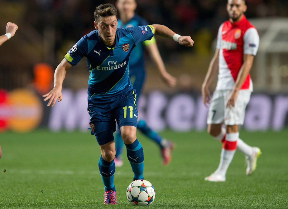 Mesut Ozil of Arsenal (centre) is tracked by Joao Moutinho of Monaco (left) during the UEFA Champions League round of 16 second leg at Stade Louis II, Monaco Picture by Russell Hart/Focus Images Ltd 07791 688 420 17/03/2015