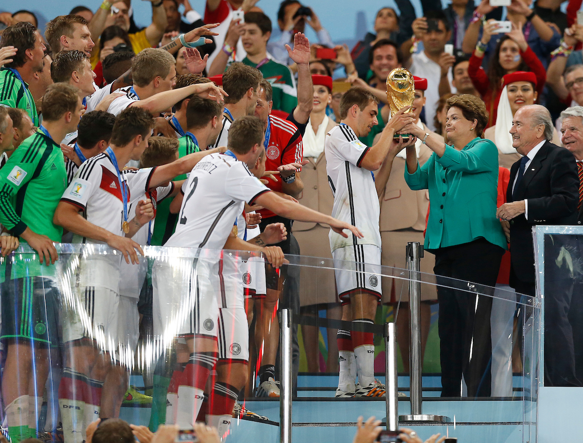 Germany's captain Philipp Lahm receives the World Cup from Brazilian President Dilma Rousseff during the 2014 FIFA World Cup Final match at Maracana Stadium, Rio de Janeiro Picture by Andrew Tobin/Focus Images Ltd +44 7710 761829 13/07/2014