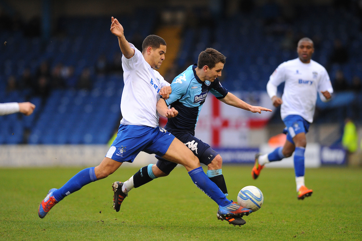 Picture by Ste Jones/Focus Images Ltd.  07706 592282.17/03/12.Giles Coke of Bury challenges Matthew Bloomfield of Wycombe Wanderers during the Npower League 1 match at Gigg Lane stadium, Bury.