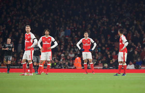 (left to right) Aaron Ramsey, Mohamed Elneny, Gabriel Paulista and Francis Coquelin of Arsenal look dejected after Ryan Bertrand of Southampton scores his side's 2nd goal to make it 0-2 during the EFL Cup match at the Emirates Stadium, London Picture by Alan Stanford/Focus Images Ltd +44 7915 056117 30/11/2016