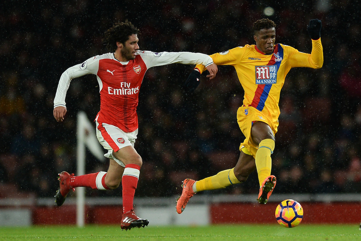 Wilfried Zaha of Crystal Palace looks to get past Mohamed Elneny of Arsenal during the Premier League match between Arsenal and Crystal Palace at the Emirates Stadium, London Picture by Richard Blaxall/Focus Images Ltd +44 7853 364624 01/01/2017