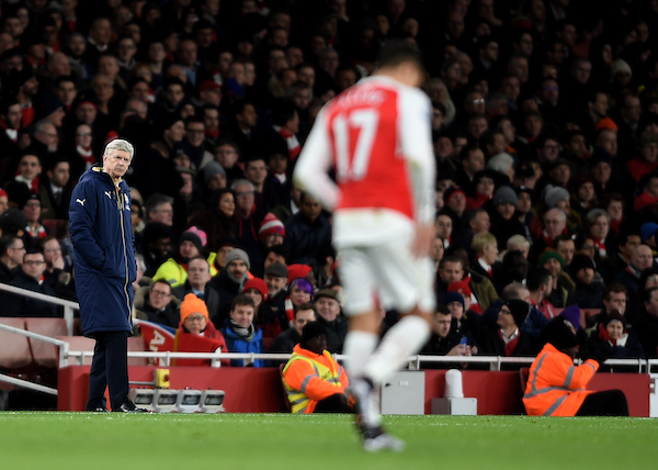 Arsenal's Alexis Sanchez winces following a tackle as manager Arsene Wenger looks on during the Barclays Premier League match at the Emirates Stadium, London Picture by Daniel Hambury/Focus Images Ltd +44 7813 022858 02/02/2016