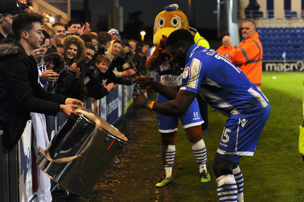 George Elokobi of Colchester United celebrates at the final whistle by banging the drum of the home fans during the Sky Bet League 2 match between Colchester United and Cheltenham Town at the Weston Homes Community Stadium, Colchester Picture by Richard Blaxall/Focus Images Ltd +44 7853 364624 02/01/2017