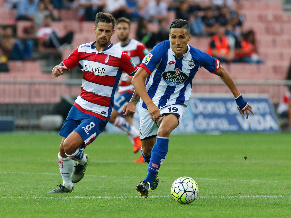 Javier Márquez Moreno of Granada CF and Fayçal Fajr of Deportivo de La Coruna during the La Liga match at Estadio Nuevo Los Cármenes, Granada Picture by Andy Zakeli/Focus Images Ltd +34 651848516 03/10/2015
