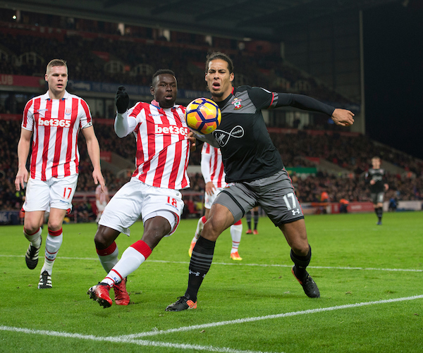 Virgil van Dijk of Southampton (right) and Mame Biram Diouf of Stoke City challenge for the ball during the Premier League match at the Bet 365 Stadium, Stoke-on-Trent Picture by Russell Hart/Focus Images Ltd 07791 688 420 14/12/2016