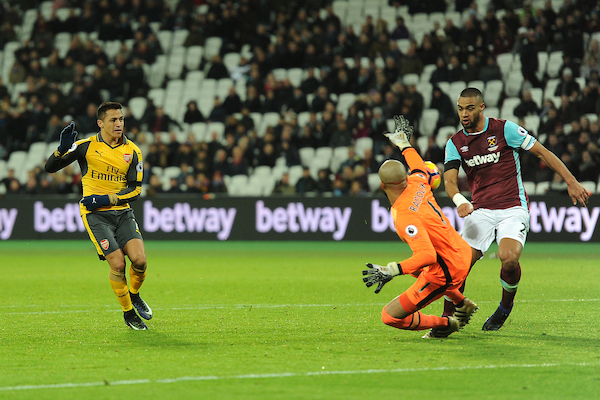 Alexis Sanchez of Arsenal scores his sides fifth goal to make the scoreline 5-1 and complete his hat-trick during the Premier League match between West Ham United and Arsenal at the London Stadium, Stratford Picture by Richard Blaxall/Focus Images Ltd +44 7853 364624 03/12/2016