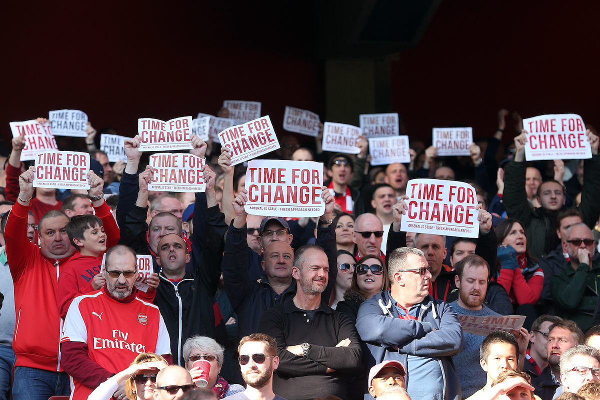 "The home fans hold up banners protesting against Arsenal Manager Arsene Wenger on the 12th minute saying ""time for change"" during the Barclays Premier League match at the Emirates Stadium, London, UK. Picture by Paul Chesterton/Focus Images Ltd +44 7904 640267 30/04/2016"