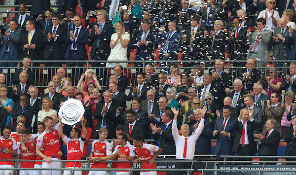 The Arsenal team lift the Charity Shield as Manager Arsene Wenger (right) celebrates after defeating Chelsea 1-0 after the FA Community Shield match at Wembley Stadium, London Picture by Alan Stanford/Focus Images Ltd +44 7915 056117 02/08/2015