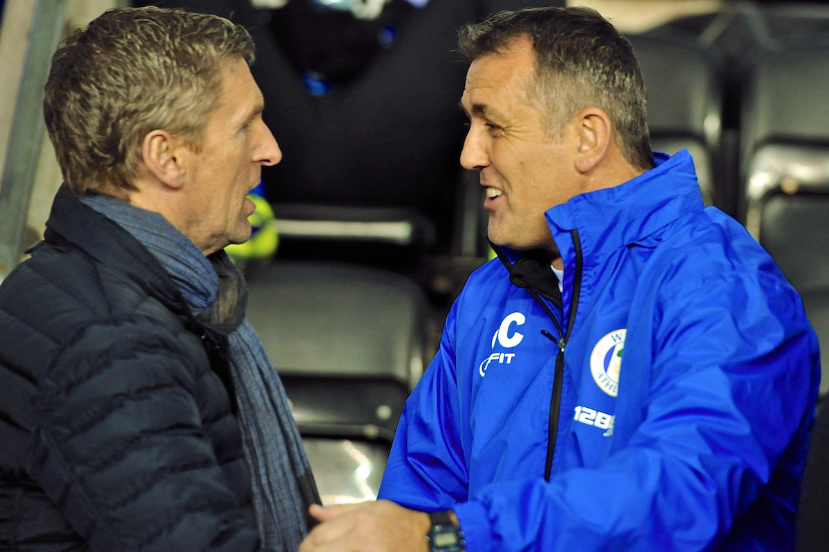 Picture by Ian Wadkins/Focus Images Ltd +44 7877 568959 28/11/2013 Wigan Athletic manager Owen Coyle (right) greets Zulte Waregem manager Francky Dury ahead of the UEFA Europa League match at the DW Stadium, Wigan.