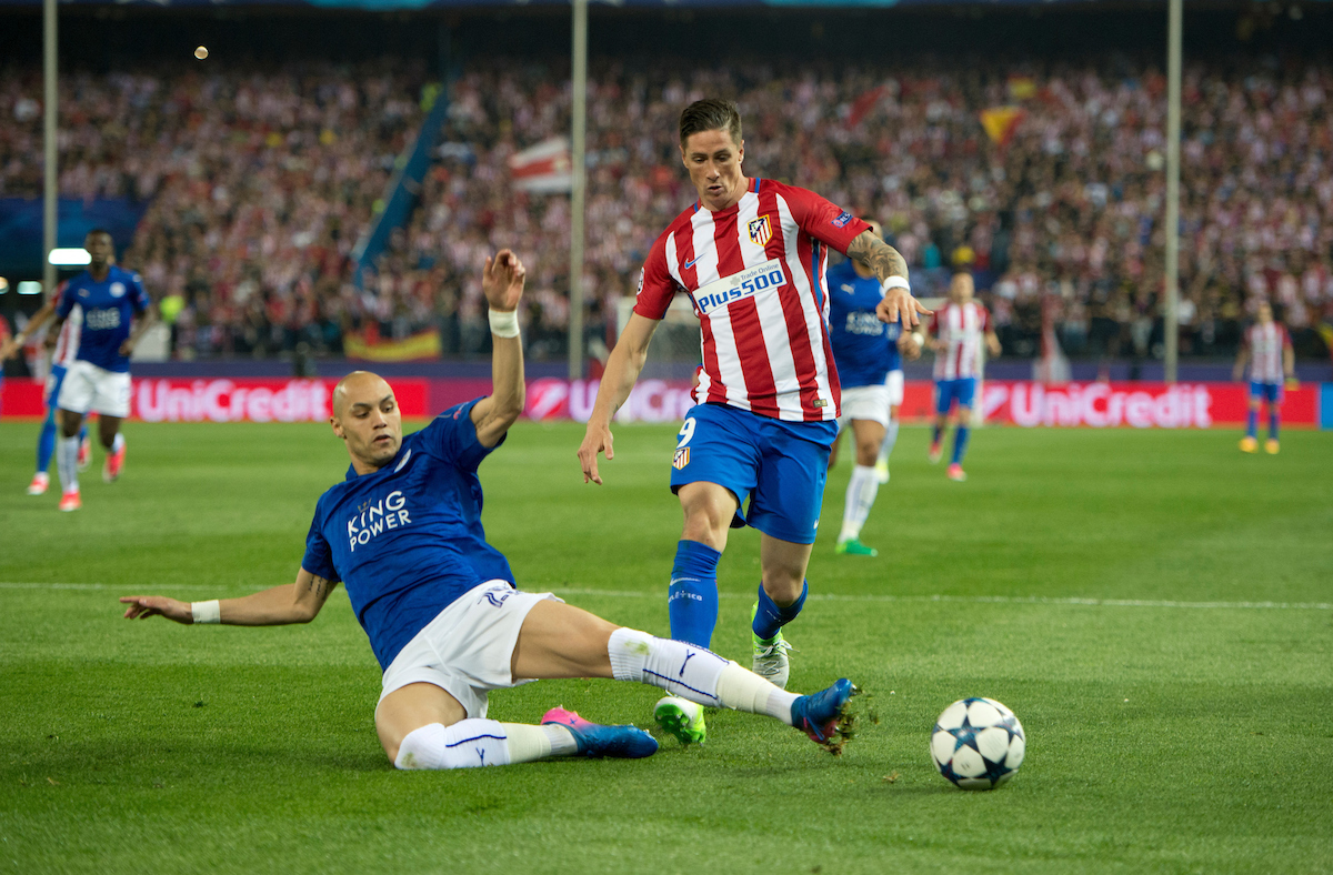 Fernando Torres of Atletico Madrid (left) is tackled by Yohan Benalouane of Leicester City during the UEFA Champions League match at Vicente Calderon Stadium, Madrid Picture by Russell Hart/Focus Images Ltd 07791 688 420 12/04/2017