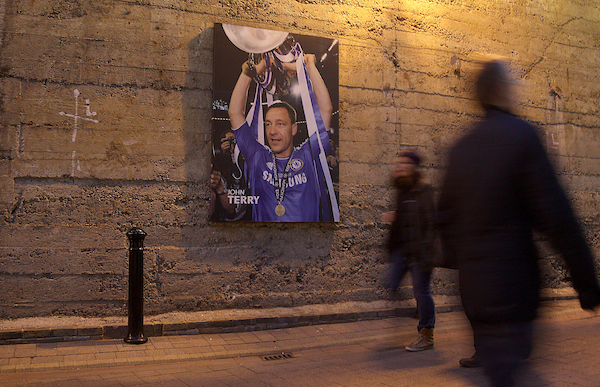 Fans walk past a picture of John Terry of Chelsea before the UEFA Champions League match at Stamford Bridge, London Picture by Paul Terry/Focus Images Ltd +44 7545 642257 11/03/2015