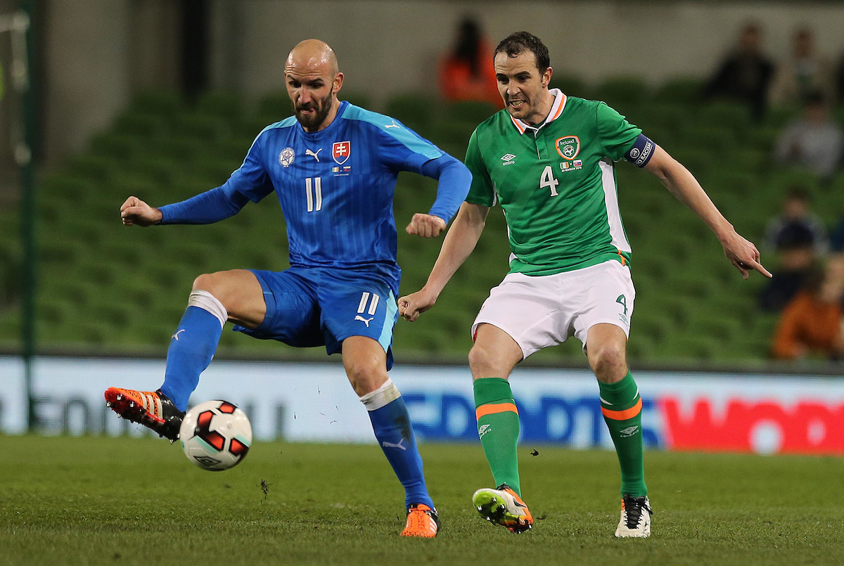 John O'Shea of Republic of Ireland and Robert Vittek of Slovakia during the International Friendly match at the Aviva Stadium, Dublin Picture by Lorraine O'Sullivan/Focus Images Ltd +353 872341584 29/03/2016