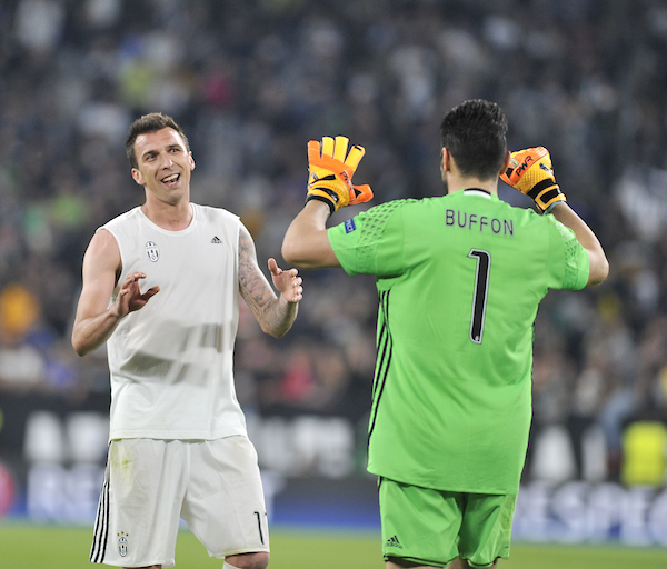Gianluigi Buffon (right) and Mario Mandzukic of Juventus celebrate victory during the UEFA Champions League match at Juventus Stadium, Turin Picture by Stefano Gnech/Focus Images Ltd +39 333 1641678 11/04/2017
