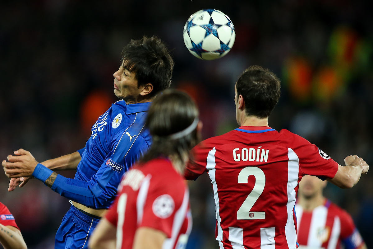 Leonardo Ulloa of Leicester City (left) competing with Diego Godin of Atletico Madrid (right) during the UEFA Champions League match at the King Power Stadium, Leicester Picture by Andy Kearns/Focus Images Ltd 0781 864 4264 18/04/2017