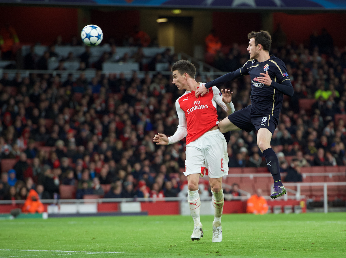 Laurent Koscielny of Arsenal wins the header from Angelo Henriquez of Dinamo Zagreb during the UEFA Champions League match at the Emirates Stadium, London Picture by Alan Stanford/Focus Images Ltd +44 7915 056117 24/11/2015